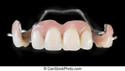 dental implants, plastic on a black background