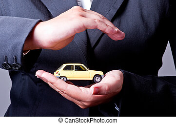 Car Insurance - Two hands facing each other, protect a...