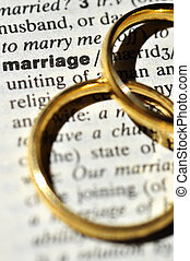 Marriage - Two wedding rings next to the word marriage on a...