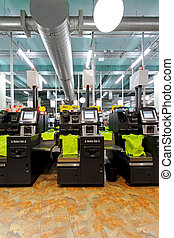 Self checkout machines - Modern self checkout machines in...