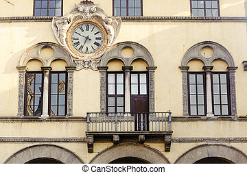 Lucca, windows and clock - Lucca (Tuscany, Italy), facade of...