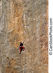 The rock-climber during rock conquest - Extreme sport The...