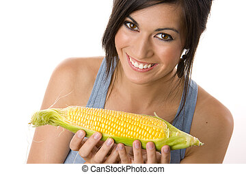 Beautiful Brunette holds a corn stalk