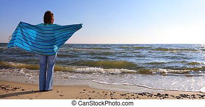 woman and shawl at sea shore - blue woman and shawl at sea...