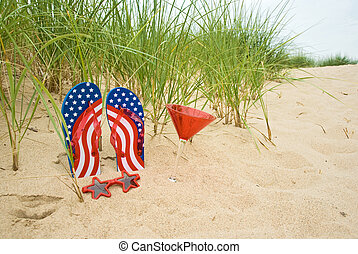 flag flip-flops in sand - Flip-flops in sand with cocktail...