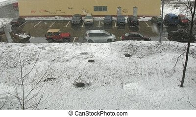 Parking in city during snow storm, view from window