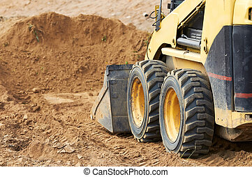 skid steer loader works - Closeup skid steer loader...