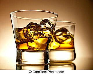 Whiskey on the rocks in old fashion glasses