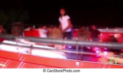 Man run in center of platform of mechanical amusement,...