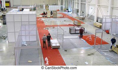 Workers disassemble the exhibition stands in Crocus Expo