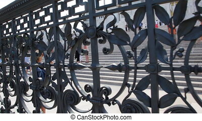 Forged metal fence near stairs Venice Square in Rome -...