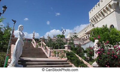Principal staircase of medieval castle shown, then camera...