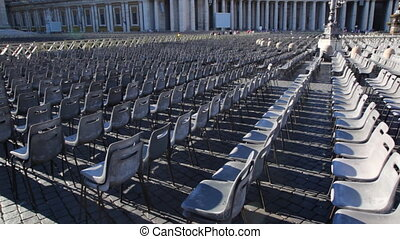 Chairs on square in front St Peters Basilica at Vatican -...
