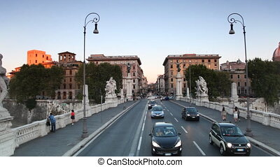 Riding through bridge Ponte Vittorio Emanuele II across...