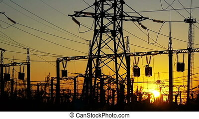 Power station at a sunset - Electricity power station at a...