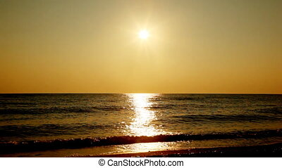 Pretty girl goes by seashore, silhouette at sunset