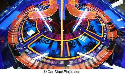 blue and orange slot machine, that rotates, child slots,...