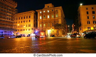 Fire truck hurry on illuminated Venice Square in Rome
