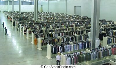 People buy clothes in Modapolis Outlet inside Crocus expo -...
