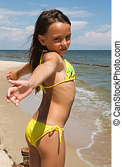 Little girl posing at the seaside - Small girl posing at the...