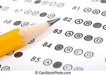 Test score sheet with answers and pencil