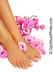 French pedicure - Feet of tanned woman with french pedicure...