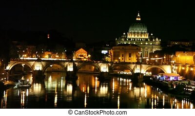 Sant Angelo Bridge side view and Sant Peters Cathedral at...