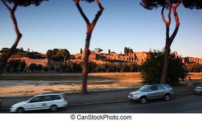 Riding through streets of Rome near historic ruins - riding...