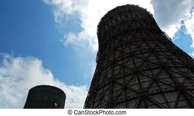 water-cooling tower against a blue sky, heat and power...