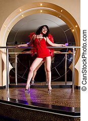 Stripper in red posing on stage