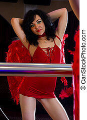 Stripper in red posing at mirror