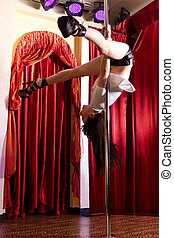 Stripper hanging on pole - Strip tease dancer hanging on the...