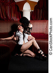 Two girls playing lesbians in nightclub - Two young adult...