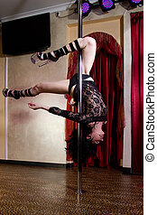 Stripper pole dancing - Strip tease dancer girl on stage in...