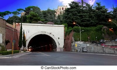 Entrance to the tunnel, the car turns and rides into it -...