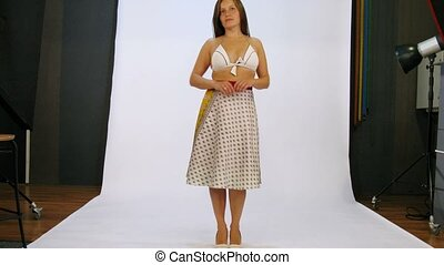 Young woman have photo session in studio - Young woman...