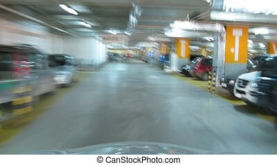 Car ride through parking in hypermarket, time lapse