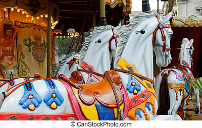 merry-go-round - colorful horses as part of a vintage...