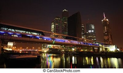 Footbridge across river near Moscow-City business center at...