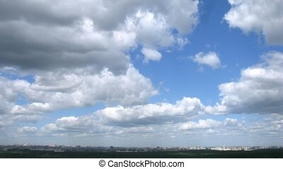 Clouds floating above Sokolniki Park, view from roof, time...