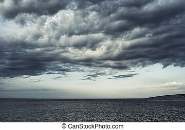 Moody sky over the sea - Dark moody sky over the gray sea