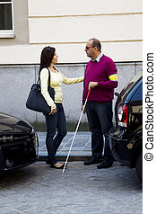 Woman and blind, visually impaired man