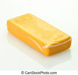 cheddar cheese - A block of sharp cheddar in a vacuum...