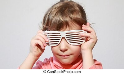 Little girl play with shutter shades glasses - Little girl...