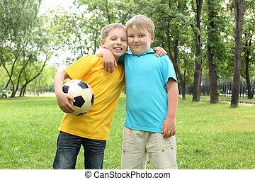 Two boys in the park - two boys in the park with a ball