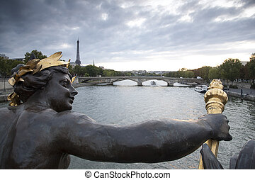 Figure on the Alexandre III Bridge looking towards the...