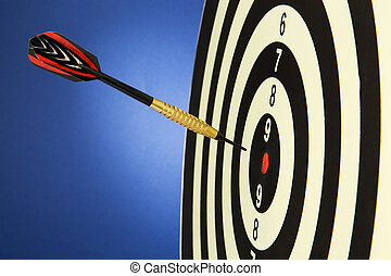 Darts with dart - An arrow game with a dart has hit the mark...