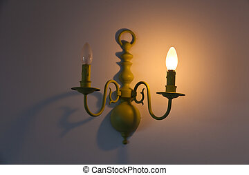 Defective indoor lighting - A defective light bulb in a...