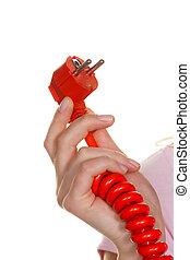 Power cord into a woman's hand - A woman's hand holding a...