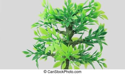Artificial ornamental plant rotates counterclockwise - Green...